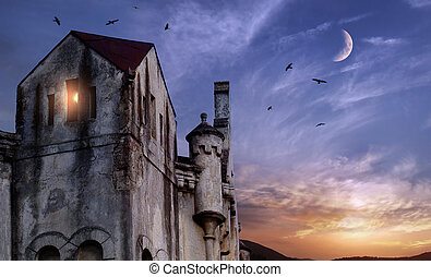 Dark castle tower with single torch in the window