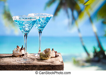 Blue drink - Fresh cocktail with blue curacao on beach...