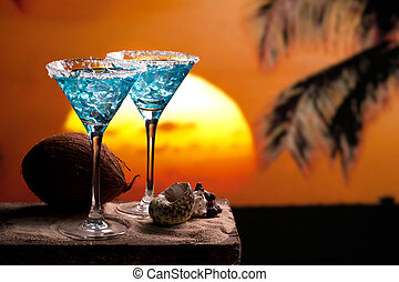 Blue Cocktail Drink - two blue cocktail on beach, sunset,...
