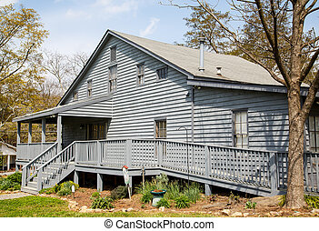 Grey Siding House with Wheelchair Ramp - An old grey wood...