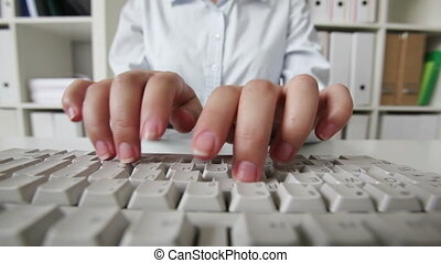 PC operator - Close-up of a female pc operator typing...