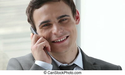 Receiving a call - Close-up of positive businessman...
