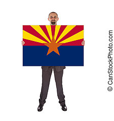 Smiling businessman holding a big card, flag of Arizona,...