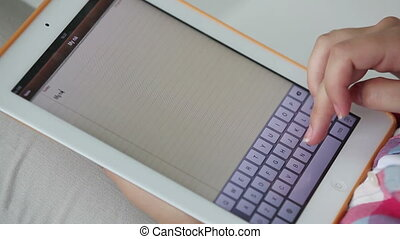 Electronic keyboard - Close-up of a female user typing on a...