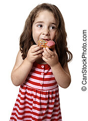 Young girl eating doughnut - Young girl eating a pink iced...