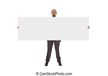 Smiling businessman holding a really big blank card,...