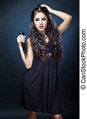 beautiful young woman singer on dark background holding...
