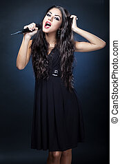 beautiful young woman singer
