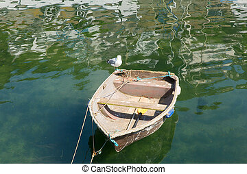 Old rough dinghy boat green sea - Old rough looking dinghy...