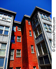 Apartment Building - Rows of Apartment Buildings with Blue...