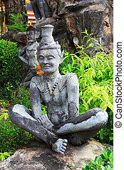 Hermit contortionist in wat pho of Thailand