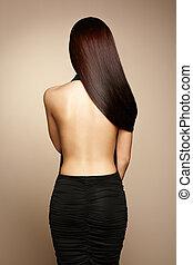 Portrait of beautiful brunette woman in black dress Fashion...
