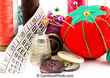 Sewing supplies - Some sewing supplies with pin, tape and...