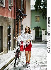 Woman in red walking on street