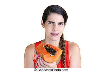 Rotten Papaya - Young woman holding a rotten Papaya in...