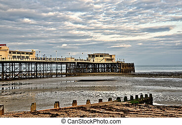 Worthing pier and groynes on the beach - Worthing Pier, a...