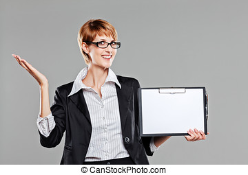 Young business woman holding a clipboard and smiling to the...