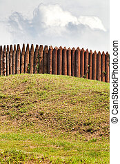 palisade of wooden stakes on rampart of old Kremlin in...