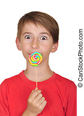 surprised boy with candy - Portrait of surprised boy with...