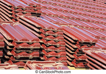 Roofing partially mounted on the roof of the large