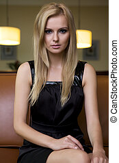 blond woman in black dress - attractive blond woman in black...