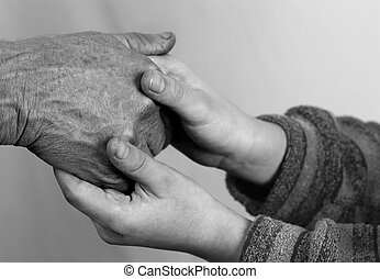 Young and Old - Old woman hands and child hands together