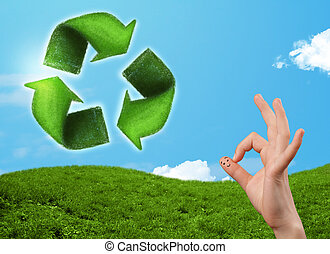 Happy smiley fingers looking at green leaf recycle sign -...
