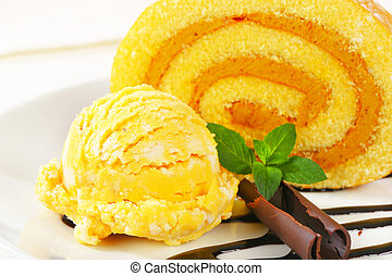 Swiss Roll with yellow sherbet - Slice of Swiss roll with...
