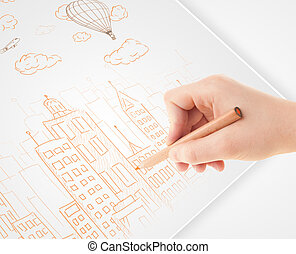 A person drawing sketch of a city with balloons and clouds...