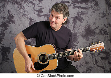 Handsome Musician Playing Guitar - Handsome mature musician...