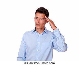 Fatigue young man with terrible headache