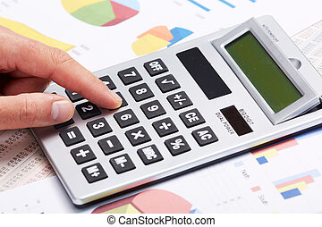 Accountant working with calculator - Hand with calculator...