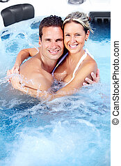 Happy couple in a hot tub - Happy couple relaxing in hot tub...