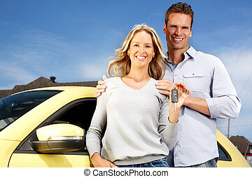 Couple with a new car key. - Happy young couple near new car...