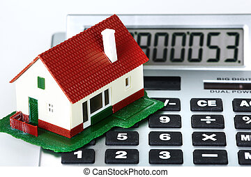 House and calculator Real estate concept background