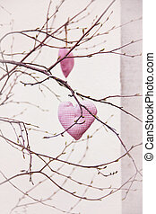 Handmade hearts hanging on the branch