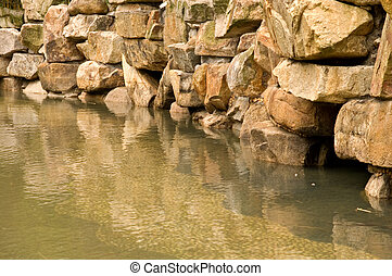 Stone pond - The stone wall of back yard pond