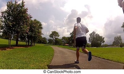 young men running in park