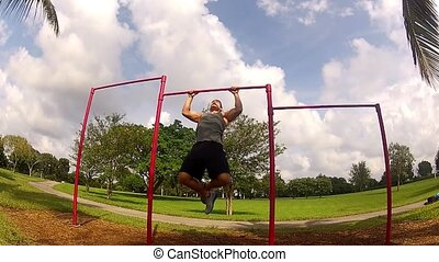 Athlete pulls on the bar Pullups