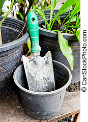 old spoon shoveling and plastic vase - Old spoon to dig a...