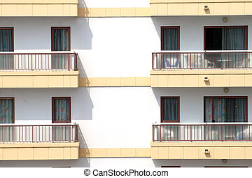 Balconies on hotel building - Closeup of hotel building with...