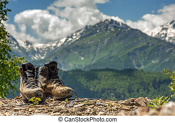 mountain - tourist boots and mountain on summer time