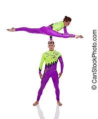 Performance of flexible acrobats in studio