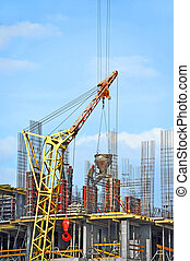 Crane lifting cement mixing container - Crane lifting...