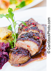 Duck breast on orange sauce with red cabbage and gratin...