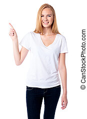 Smiling woman pointing up with her finger