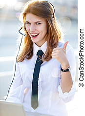 Busy Call Center Operator Girl show - smiling brunette girl...