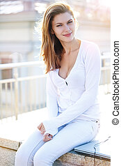 Delightful young woman just sitting