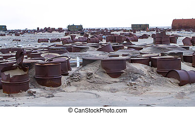 drums on Arctic coast - Rusty fuel and chemical drums on...