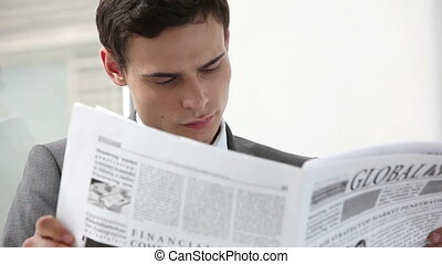 Daily pages - Close-up of a white-collar worker looking...